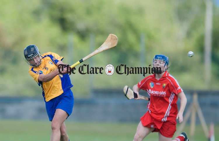 Ruth Kaiser of Clare clears ahead of the challenge of Briege Corkery. Photograph by Declan Monaghan