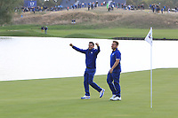Rory McIlroy and Tyrrell Hatton (Team Europe) on the 18th green during the Sunday Singles of the Ryder Cup, Le Golf National, Ile-de-France, France. 30/09/2018.<br /> Picture Thos Caffrey / Golffile.ie<br /> <br /> All photo usage must carry mandatory copyright credit (© Golffile | Thos Caffrey)