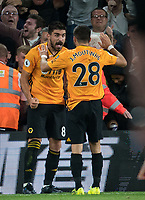 Rubén Neves celebrates his goal with João Moutinho of Wolves during the Premier League match between Wolverhampton Wanderers and Manchester United at Molineux, Wolverhampton, England on 19 August 2019. Photo by Andy Rowland.