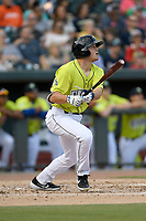 First baseman Brian Sharp (7) of the Columbia Fireflies bats in a game against the Charleston RiverDogs on Saturday, April 6, 2019, at Segra Park in Columbia, South Carolina. Columbia won, 3-2. (Tom Priddy/Four Seam Images)