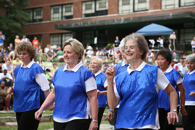 Members of the Donovan Scholars Program, an initiative that offers free education to persons aged 65 or older through UK, perform a step dancing jazzercise routine during We Are UK in Lexington, Ky., on Tuesday, August 27, 2013. Photo by Adam Pennavaria | Staff
