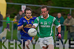 Eoin Cronin Spa chases Jerome Kelleher Milltown during their county league game in Milltown on Saturday evening