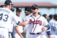 Peoria Javelinas first baseman Braxton Davidson (34), of the Atlanta Braves organization, shakes hands with manager Daren Brown (43) during player introductions before the Arizona Fall League Championship game against the Salt River Rafters at Scottsdale Stadium on November 17, 2018 in Scottsdale, Arizona. Peoria defeated Salt River 3-2 in 10 innings. (Zachary Lucy/Four Seam Images)