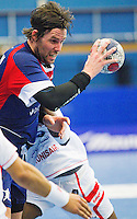 06 APR 2012 - LONDON, GBR - Great Britain's Steven Larsson (GBR) looks for a way through the Tunisian defence during the men's 2012 London Cup match at the National Sports Centre in Crystal Palace, Great Britain (PHOTO (C) 2012 NIGEL FARROW)