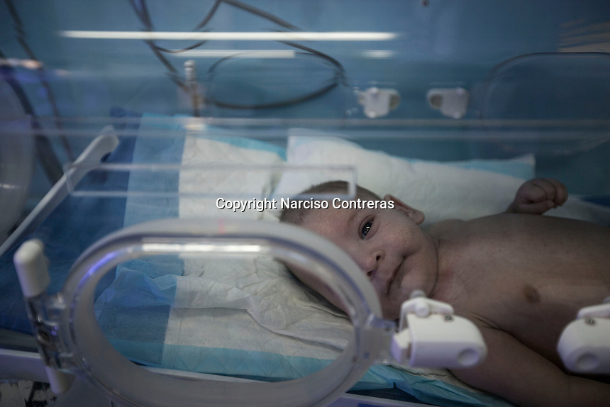 June 11, 2015 - Bekaa Valley, Lebanon: A new born Syrian orphan baby lays inside an incubator at Rahme hospital in Taanayel city in east of Lebanon. The baby as many like him with Syrian roots was born stateless after their parents fled years ago from their hometowns in Syria when opposition armed groups started battling against the government of President Bashar Al-Assad. (Photo/Narciso Contreras)
