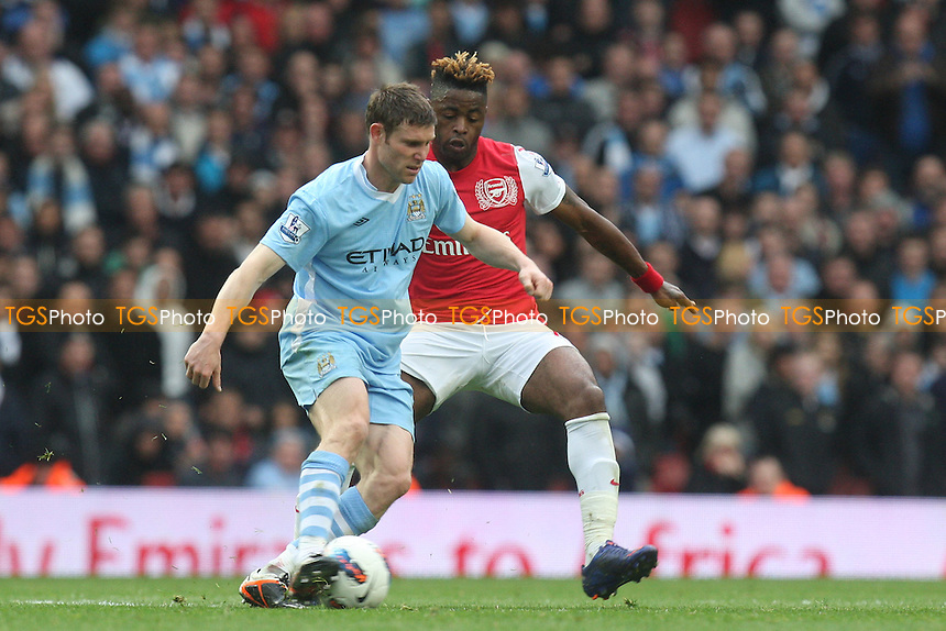 James Milner of Manchester City and Alexandre Song of Arsenal -  Arsenal - Manchester City at the Emirates Stadium - 08/04/12 - MANDATORY CREDIT: Dave Simpson/TGSPHOTO - Self billing applies where appropriate - 0845 094 6026 - contact@tgsphoto.co.uk - NO UNPAID USE.