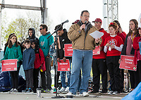 NWA Democrat-Gazette/BEN GOFF @NWABENGOFF<br /> Twenty five heart dissease and stroke survivors and their families take the stage for recognition Saturday, April 13, 2019, during the Northwest Arkansas Heart Walk starting from the Walmart Arkansas Music Pavilion in Rogers. This year is the 25th anniversary for the American Heart Association's annual walk with locations around the country. This year's Northwest Arkansas walk raised more than $1 million with donations still coming in as of Saturday morning, said to Lauren Wheeler with the American Heart Association Northwest Arkansas.