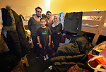 Itemad Al-Asadi poses with three of her sons in their room in a refugee shelter in Vienna, Austria. While their applications for asylum are being considered, the Iraqi family lives in this temporary shelter constructed in a branch of the Erste Bank. The shelter is coordinated by Johanniter-Unfall-Hilfe Österreich, a member of the Diakonie network in Austria, which is a member of the ACT Alliance. Some 85 refugees currently live in the former bank, and several bank employees volunteer to assist the refugees sheltered there.