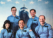 Dr. Sally Ride, left, poses with her STS-7 crewmates.  In addition to launching America's first female astronaut, it was also the first mission with a five-member crew.  Front row, left to right: Dr. Sally Ride, Commander Bob Crippen, Pilot Frederick Hauck.  Back row, left to right: John Fabian, Norm Thagard..Credit: NASA via CNP