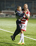 Dougie Imrie lifts up and dances with a Hamilton ballboy after winning penalty shootout in the Scottish Cup
