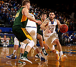 BROOKINGS, SD - DECEMBER 28:  Michael Orris #50 from South Dakota State drives around a screen against North Dakota State during their game Wednesday night at Frost Arena in Brookings. (Dave Eggen/Inertia)