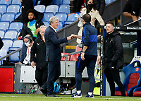 7th July 2020; Selhurst Park, London, England; English Premier League Football, Crystal Palace versus Chelsea; Crystal Palace Manager Roy Hodgson fist bumps Chelsea Manager Frank Lampard after full time
