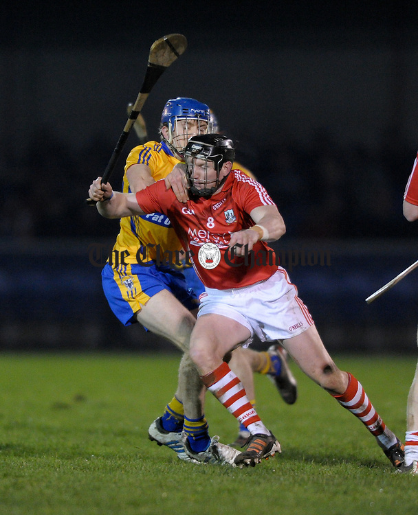 Shane O Donnell of Clare in action against Rob O Shea of Cork during the Waterford Crystal cup semi-final at Sixmilebridge. Photograph by John Kelly.
