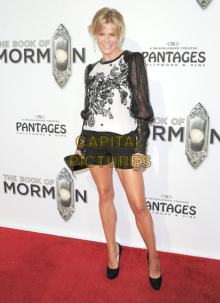 "Julie Bowen.""The Book of Mormon"" Hollywood Opening night Held At The Pantages theatre, Hollywood, California, USA..September 12th, 2012.full length white sheer lace sleeves floral print top shorts clutch bag black .CAP/DVS.©DVS/Capital Pictures."
