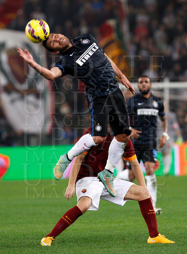 Calcio, Serie A: Roma vs Inter. Roma, stadio Olimpico, 30 novembre 2014.<br /> FC Inter&rsquo;s Gary Medel heads the ball during the Italian Serie A football match between AS Roma and FC Inter at Rome's Olympic stadium, 30 November 2014.<br /> UPDATE IMAGES PRESS/Riccardo De Luca