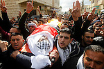 Mourners carry the body of Palestinian Firas Khdoor, who according to the Israeli military was shot dead after he carried out a car ramming attack last September, during his funeral after Israel released his body, in the West Bank village of Bani Naem, near Hebron December 17, 2016. Photo by Wisam Hashlamoun
