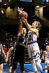 SIOUX FALLS, SD - MARCH 19: Tess Bruffey #54 from Lubbock Christian takes the ball to the basket against Kayonne Lee #3 from Central Missouri during their quarterfinal game at the 2018 Elite Eight Women's NCAA DII Basketball Championship at the Sanford Pentagon in Sioux Falls, SD. (Photo by Dave Eggen/Inertia)