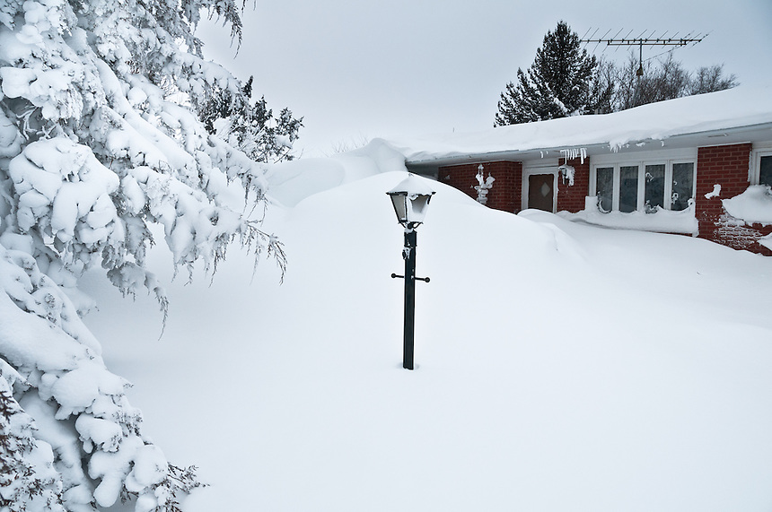 Snowdrifts in Bradshaw Nebraska reach to roof-top level after a raging blizzard on Christmas day in 2009.