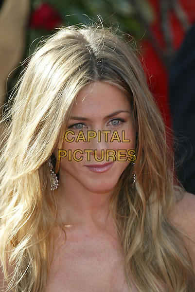 JENNIFER ANISTON.At the 56th Annual Prime Time Emmy Awards held the Shrine Auditorium, Los Angeles, CA, USA, .19th September, 2004..portrait headshot earrings .Ref: ADM.www.capitalpictures.com.sales@capitalpictures.com.©Charles Harris/AdMedia/Capital Pictures .