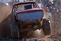 "Mud pit racing, mud racing, mud running or simply muddin"" is a form of off road racing in which the goal is to drive a vehicle through a pit of mud of a set length. Winners are determined by the distance traveled through the pit or, if several vehicles are able to travel the entire length, the time taken to traverse the pit.  This mud race was a part of the Poteau Balloon Fest held on Halloween weekend 2009 in Poteau Okllahoma."
