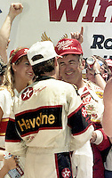 Davey Allison congratulates Bobby Allison victory lane Pepsi Firecracker 400 Daytona International Speedway Daytona Beach FL July 1987 (Photo by Brian Cleary/www.bcpix.com)
