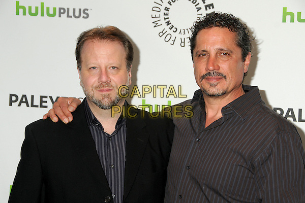 "Andrew Marlowe, Rob Bowman.PaleyFest 2012 Presents ""Castle"" held at The Saban Theatre, Beverly Hills, California, USA, 9th March 2012..half length arm around black jacket grey gray shirt striped  .CAP/ADM/BP.©Byron Purvis/AdMedia/Capital Pictures."