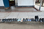 Children's shoes are lined up outside a classroom during nap time at the Jairos Jiri School for people living with disabilities in Bulawayo, Zimbabwe.