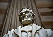 A statue of Abraham Lincoln, the 16th President of the United States, stands inside the Rotunda of the US Capitol, December 3, 2018 in Washington, DC. - The body of the late former President George H.W. Bush will travel from Houston to Washington, where he will lie in state at the US Capitol through Wednesday morning. Bush, who died on November 30, will return to Houston for his funeral on Thursday. (Photo by Brendan Smialowski / AFP) / POOL PHOTO