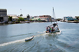 BELIZE, Belize City, fishermen return to the harbor after a morning on the water