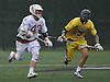 Lucas Cotler #43 of Syosset, left, gets pressured by James DeTommaso #29 of Massapequa during a Nassau County varsity boys lacrosse game at Syosset-Woodbury Community Park on Tuesday, May 3, 2016. Cotler scored four goals in Syosset's 13-12 win.