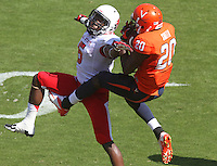 Virginia wide receiver Tim Smith (20) makes a catch in front of Ball State cornerback Eric Patterson (5) during the football game Saturday Oct. 5, 2013 at Scott Stadium in Charlottesville, VA. Ball State defeated Virginia 48-27. Photo/The Daily Progress/Andrew Shurtleff