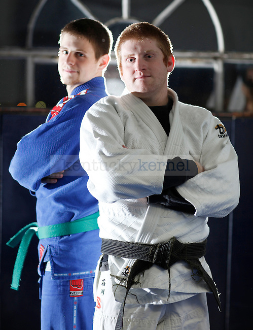 Judo Club Sensei Robert Burge, right, and Judo Club President  Alex Mohn, a mechanical engineering junior, both have a passion for Judo. Burge, the head instructor, found his interest in Judo on accident when he showed up for another martial arts club UK offered. He said he saw the workout in which participants were throwing and locking one another in armbars, and was immediately interested. Photo by Zach Brake | Staff