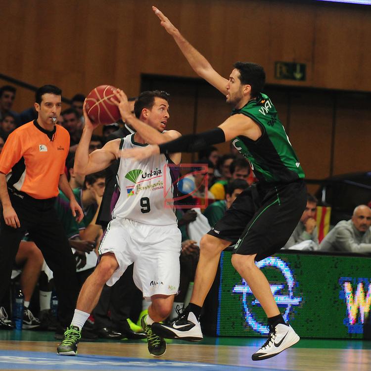 League ACB-Endesa 2014/2015 - Game: 06.<br /> FIATC Joventut vs Unicaja: 82-74.<br /> Ryan Toolson vs Sergi Vidal.