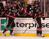 Zach Aston-Reese (NU - 12), Curtis Frye (NU - 31), Nolan Stevens (NU - 21) - The Harvard University Crimson defeated the Northeastern University Huskies 4-3 in the opening game of the 2017 Beanpot on Monday, February 6, 2017, at TD Garden in Boston, Massachusetts.