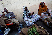 Women sell Khat, a local drug at the main market in Baidoa, Somalia on Wednesday January 03 2007..Only a few days after the fall of the United Islamic Courts in Mogadishu, Ethiopian and Transitional Federal Government troops are patrolling the city and securing strategic locations..The people in Mogadishu appear confused and doubtful on t