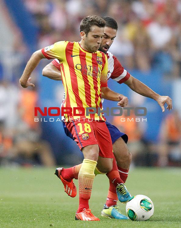 Atletico de Madrid's Arda Turan (r) and FC Barcelona's Jordi Alba during Supercup of Spain 1st match.August 21,2013. Foto © nph / Acero)
