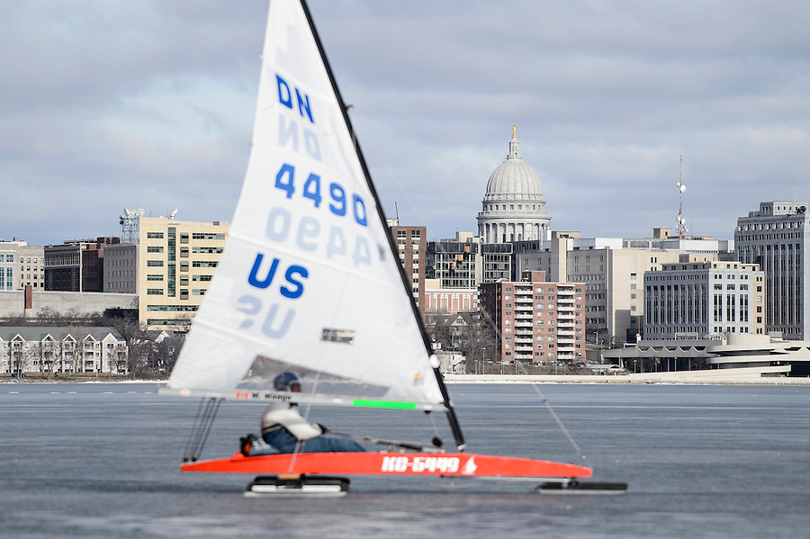 Participants prepare their iceboats for competition in the North American Championship DN Ice Sailing Regatta on frozen Lake Monona in Madison, Wis., during winter on Feb. 25, 2016. In the background is the downtown Madison skyline, including the Wisconsin State Capitol. (Photo by Jeff Miller, www.jeffmillerphotography.com)