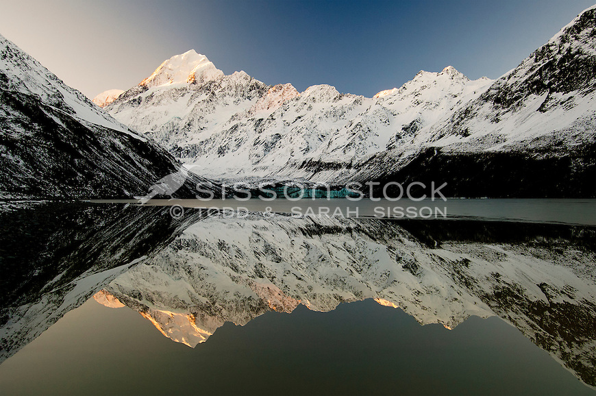 Sunset Reflection of Mt Cook in the Hooker Glacier terminal lake.
