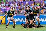 Jordan Bunce of New Zealand (R) passes the ball during the HSBC Hong Kong Sevens 2018 Bronze Medal Final match between South Africa and New Zealand on 08 April 2018 in Hong Kong, Hong Kong. Photo by Marcio Rodrigo Machado / Power Sport Images