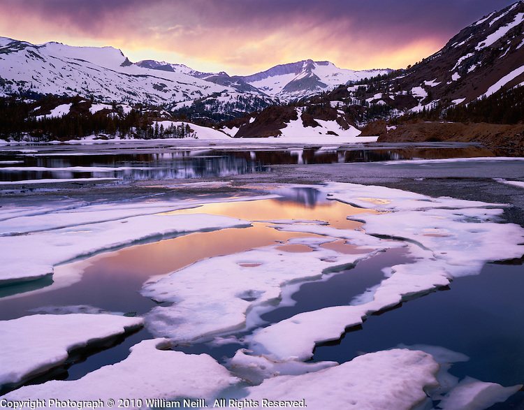 Spring ice thawing on Ellery Lake with White Mountain and Mount Conness on the Sierra crest, Inyo National Forest, California