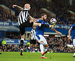 Jonjo Shelvey of Newcastle United challenges Cenk Tosun of Everton during the premier league match at Goodison Park Stadium, Liverpool. Picture date 23rd April 2018. Picture credit should read: Simon Bellis/Sportimage