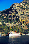 Tourist ferry boat International in water at dock in the marina on Upper Waterton Lake National Park Alberta Canada