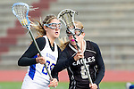 Torrance, CA 05/09/13 - Alix Davies (Agoura #25) and Julia Gilliam (Oak Park #8) in action during the 2013 Los Angeles area Girls Varsity Lacrosse Championship.  Agoura defeated Oak Park 13-7.