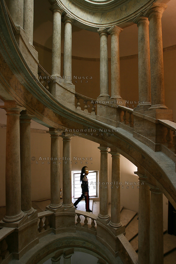 A Cuirassier walks down the winding staircase at the Quirinale in Rome. The Cuirassiers' Regiment is an elite Italian military unit and the honor guard of the President of the Italian Republic.