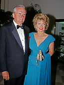 Chairman and CEO, Atlantic Richfield Company, Lodwrick M. Cook and his wife, Carole, arrive at the White House in Washington, DC for the State Dinner in honor of President Patricio Aylwin of the Republic of Chile on Wednesday, May 13, 1992.<br /> Credit: Ron Sachs / CNP