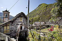 Switzerland. Canton Ticino. Corippo lies in the Verzasca valley. The stone houses are built from the local Ticino granite with stones roofs and have changed little for several hundred years. With a population of just 16, Corippo is the smallest municipality in Switzerland. Despite this, it possesses the trappings of communities many times its size such as its own coat of arms and a town council consisting of three local citizens. A town council is a democratically elected form of government for small municipalities. A council may serve as both the representative and executive branch. The village has maintained its status as an independent entity since its incorporation in 1822. 8.05.13 © 2013 Didier Ruef