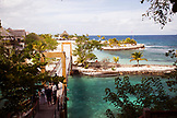 JAMAICA, Oracabessa. A view of the bridge and beach at the Goldeneye Hotel and Resort.