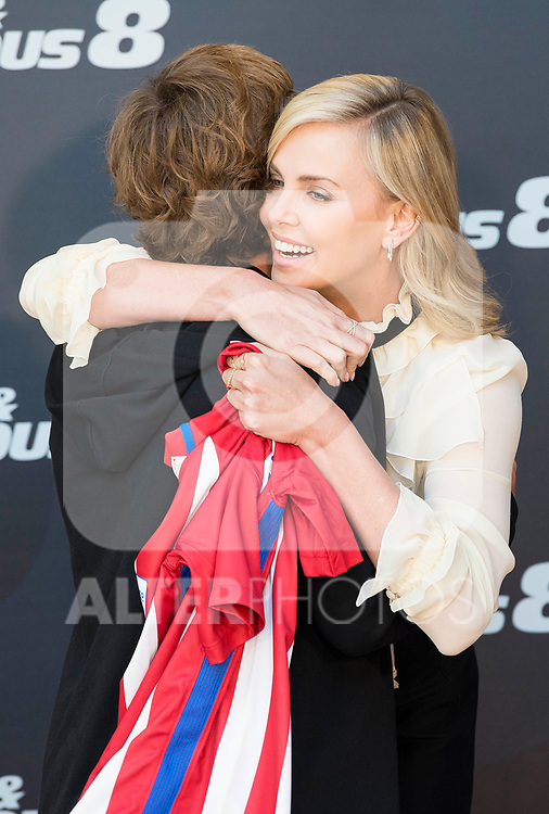 "South African actress Charlize Theron with Atletico de Madrid's player Antoine Griezmann  during the presentation of the film ""Fast & Furious 8"" at Hotel Villa Magna in Madrid, April 06, 2017. Spain.<br /> (ALTERPHOTOS/BorjaB.Hojas)"