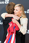 South African actress Charlize Theron with Atletico de Madrid's player Antoine Griezmann  during the presentation of the film &quot;Fast &amp; Furious 8&quot; at Hotel Villa Magna in Madrid, April 06, 2017. Spain.<br /> (ALTERPHOTOS/BorjaB.Hojas)