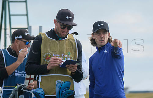 July 6th 2017, Portstewart Golf Club, Portstewart, Northern Ireland; Dubai Duty Free Irish Open Golf Championship; Day 1; Tommy Fleetwood (ENG) discusses the 10th tee shot with his caddy
